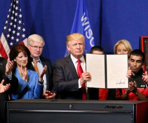 Trump Signs Order That Could Lead to Curbs on Foreign Workers